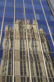 Chicago,Tribune Tower. Downtown chicago reflection of the Tribune Tower in a large window facade with blue sky as a vertical image stock photos