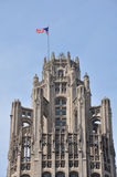 Chicago Tribune Tower Top. Flag waving atop the Tribune Tower in Chicago, Illinois Stock Photo