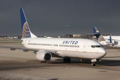 CHICAGO, UNITED STATES - APRIL 15, 2014: United Airlines Boeing 737 at O 'Hare Airport in Chicago. It was the 5th busiest airport. In the world with 66,883,271 stock images
