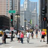Chicago. UNITED STATES - JUNE 27, 2013: People walk downtown in .  is the 3rd most populous US city with 2.7 million residents (8.7 million in its urban area Stock Photo