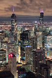 Chicago Urban aerial view at dusk. Chicago urban skyline panorama aerial view with skyscrapers and cloudy sky at dusk with lights Royalty Free Stock Images
