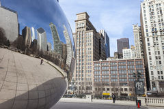 CHICAGO, USA - APRIL 02: Cloud Gate and Chicago skyline on April Stock Photography