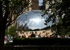 Chicago, USA - June 05, 2018: People near the Cloud Gate, a public sculpture by Anish Kapoor at Millennium Park. Cloud Gate, also stock photography