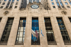 Chicago, USA - May 30, 2016: Closeup of Board of Trade Building along LaSalle street in Illinois with a clock, two clerks and an e Stock Image