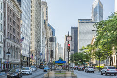 Chicago, USA - May 30, 2016: Divided street with traffic on South Michigan Avenue in downtown with cars and skyscrapers Stock Images