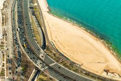 Chicago, USA: View on the highway with traffic, sand beach and the Lake Michigan Royalty Free Stock Photos