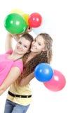 Chicas jóvenes con los globos sobre blanco Fotografía de archivo libre de regalías