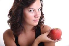 Chicas jóvenes con una manzana Imagenes de archivo