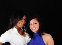 Chicas jóvenes en backround negro Fotografía de archivo libre de regalías