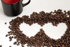 Chicchi di caffè con figura del cuore Fotografia Stock