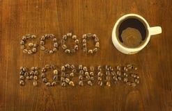 Chicchi di caffè di buongiorno fotografia stock