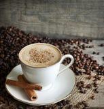 Chicchi di caffè e del Cappuccino Fotografie Stock
