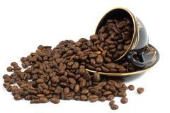 Chicchi di caffè e della tazza Fotografie Stock