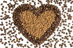 Chicchi di caffè nella figura del cuore Fotografie Stock