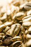Chicchi di caffè puri dell'oro Immagini Stock Libere da Diritti