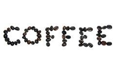 Chicchi di caffè su fondo bianco Fotografia Stock
