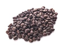 Chicchi di caffè Su una priorità bassa bianca immagini stock libere da diritti