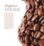 Chicchi di caffè sulla scheda Immagine Stock Libera da Diritti
