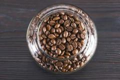 Chicchi di caffè in un vaso di vetro Immagine Stock