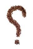 Chicchi di caffè in una forma di un punto interrogativo Immagini Stock
