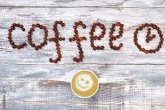 Chicco di caffè, tazza del cappucino Fotografia Stock
