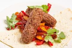 Chiche-kebab et légumes en sauce Photo libre de droits