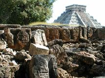 Chichen Itza 2. Chichen Itza piramid over the stone carvings Royalty Free Stock Photo