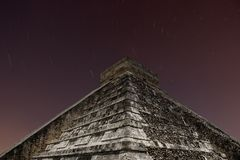 Chichen Itza. Ancient Mayan pyramid of Kukulcan at nigth with star trails at Chichen Itza, Yucatan, Mexico Royalty Free Stock Image