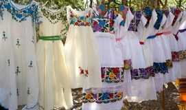 Chichen itza embroided dresses Mexico. Chichen itza embroided dresses in outdoor shop Mexico Yucatan royalty free stock photo