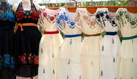 Chichen itza embroided dresses Mexico. Chichen itza embroided dresses in outdoor shop Mexico Yucatan royalty free stock image