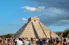 CHICHEN ITZA, MEXICO - MARCH 21,2014: Tourists watching the feathered serpent crawling down the temple Equinox March 21 2014 Royalty Free Stock Photography