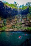 CHICHEN ITZA, MEXICO - NOVEMBER 12, 2017: Unidentified young people swimming in Ik-Kil Cenote near Chichen Itza, Mexico. Lovely cenote with transparent Royalty Free Stock Photo