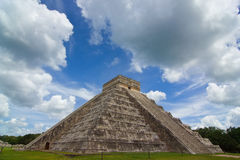 Chichen itza pyramid in a blue sky day back view. Chichen itza pyramid in a blue sky white clouds day back view Stock Images