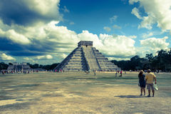 Chichen Itza pyramid. CHICHEN ITZA, MEXICO - NOVEMBER 29, 2012: anonymous tourists do sightseeing of Kukulkan pyramid in Chichen Itza, Mexico Royalty Free Stock Photos