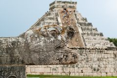 Chichen Itza Pyramid with Snake Head in Foreground Royalty Free Stock Photography