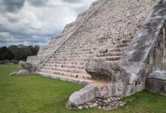 Chichen Itza pyramid stairs. With snake head under a storm, in Riviera Maya, Mexico Royalty Free Stock Images