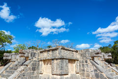 Chichen Itza Ruins and Sky. Platform of the Eagles and Jaguars with a beautiful blue sky in the ruins of Chichen Itza in Mexico Royalty Free Stock Photo