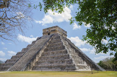 Chichen Itza. The Temple of Kukulkan (El Castillo) in the Mayan city of Chichen Itza, Mexico framed by trees Stock Image