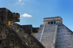 Chichen Itza wall and temple in background Stock Images