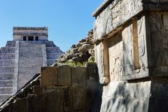 Chichen Itza wall with temple in background Stock Image