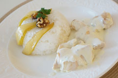 Chichen with rice and pear-italian food royalty free stock photography