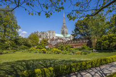 Chichester in Sussex. Chichester Cathedral viewed from the beautiful Bishops Palace Gardens in the historic cathedral city of Chichester in West Sussex, UK stock images