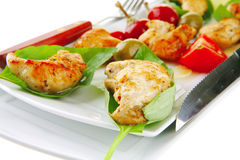 Chick chops in green leaf Stock Image