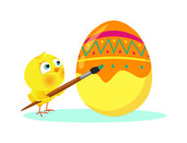 Chick dyeing Easter egg Royalty Free Stock Photo