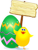 Chick, Easter egg and sign Royalty Free Stock Photo