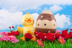 A chick egg shell with an easter egg Royalty Free Stock Photo