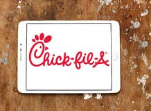 Chick-fil-A fast food restaurant logo. Logo of Chick-fil-A fast food restaurant on samsung tablet. Chick-fil-A is an American fast food restaurant chain royalty free stock photos