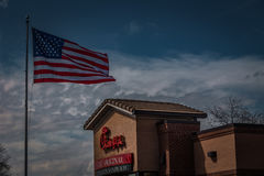 Chick-Fil-A Restaurant Exterior with US Flag Royalty Free Stock Photography
