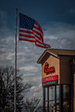Chick-Fil-A Restaurant with US Flag Stock Photography