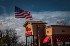 Chick-Fil-A Restaurant with USA Flag Stock Images